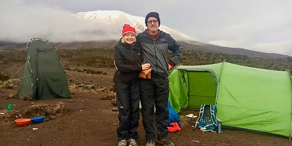 Toilet tent on the Left, Sleeping tent on the Right, KILI in the distance
